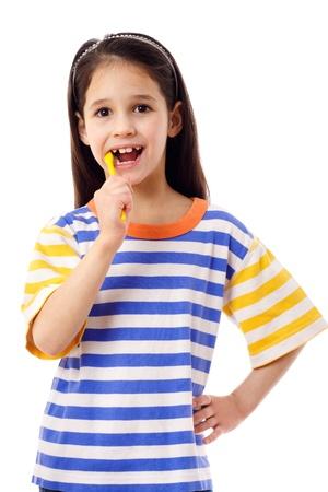 Smiling girl brushing teeth, isolated on white Stock Photo - 12353556
