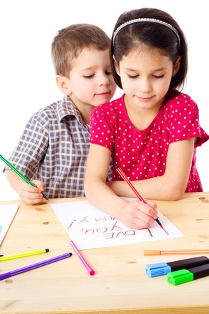 Two little kids at the table draw with crayons for mum, isolated on white Stock Photo - 12353563