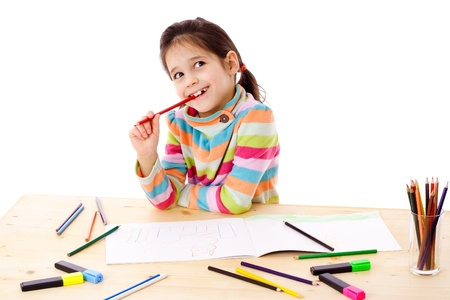 Inspired little girl at the table draw with crayons, isolated on white Stock Photo - 12353651