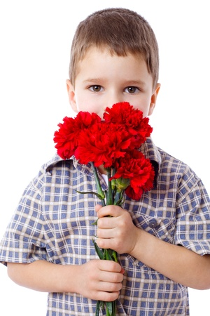 HESITATE: Boy with bouquet of red carnations, isolated on white Stock Photo