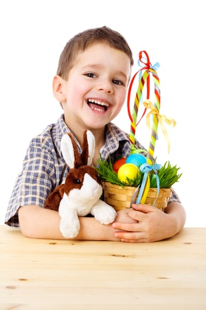 Smiling boy with easter eggs and bunny, isolated on white photo