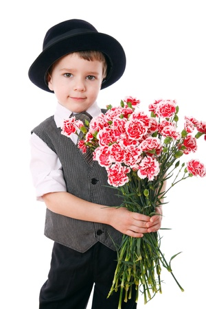 mother day: Little boy holds a bouquet of pink carnations, isolated on white