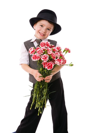 giving gift: Little boy standing with a bouquet of pink carnations, isolated on white Stock Photo