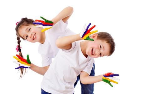 dirty girl: Bambini felici con le mani dipinte, isolato su bianco Archivio Fotografico