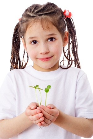earth handful: Girl with little sprouts in hands, isolated on white