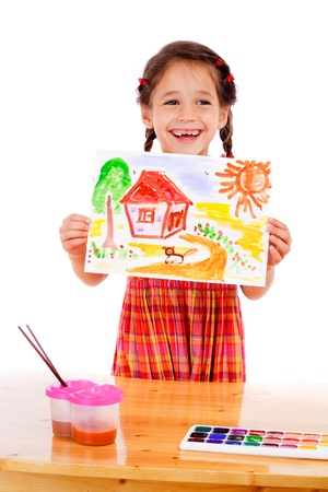 Smiling little girl with watercolor painting, isolated on white photo