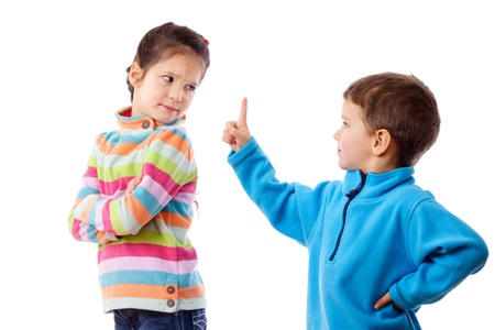 defiant: Two children who are arguing, isolated on white