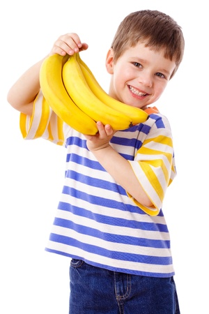 niños comiendo: Niño feliz tiene un racimo de plátanos, aislado en blanco Foto de archivo