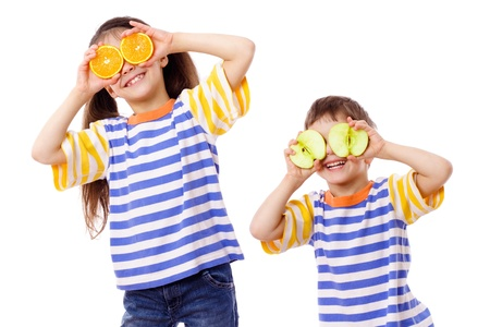 Two funny kids with fruits on face, isolated on white Stock Photo - 12897816