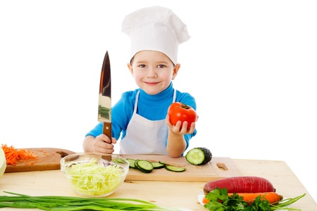 Little cook with knife and tomatoes in hands, isolated on white photo
