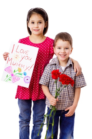 Two kids with greetings for mum, isolated on white photo