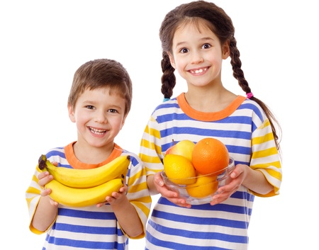 healthy snacks: Happy kids holds a tropical fruits, isolated on white