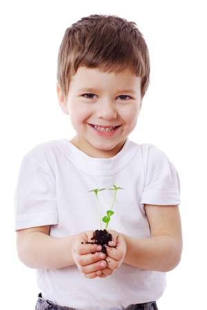 Smiling boy with sprouts in hands, isolated on white photo