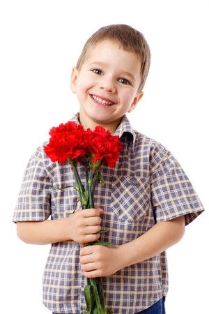 mother day: Smiling boy with bouquet of red carnations, isolated on white