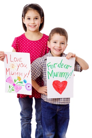 Two kids with greeting cards for mum, isolated on white photo