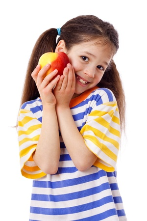 Happy girl with apple, isolated on white photo