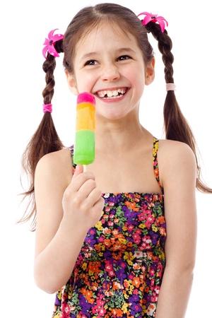 ice cream on stick: Ni�a feliz con crema de agua con hielo, aislado en blanco Foto de archivo