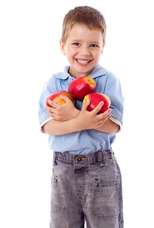 dessert stand: Happy boy holds a three red apples, isolated on white Stock Photo