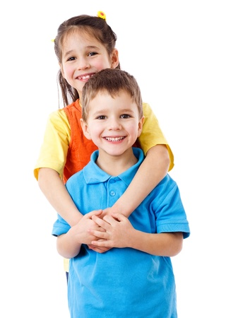 kids hugging: Two happy kids standing together, isolated on white Stock Photo