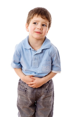 ağrı: Little boy showing stomach pain, isolated on white