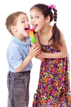 Girl and boy licking ice cream together, isolated on white photo