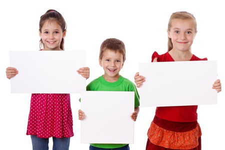 holding a sign: Three smiling kids standing with empty blank in hands, isolated on white