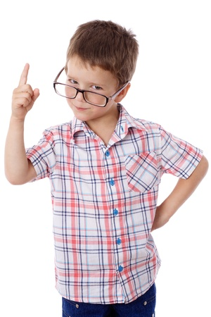 one little boy: Serious little boy in glasses with empty pointing hand, isolated on white Stock Photo