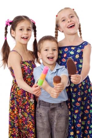 Three kids show their ice cream, isolated on white photo