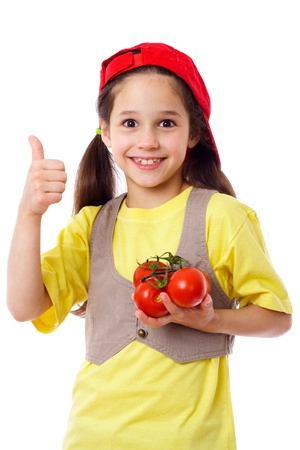 ok sign: Smiling girl in red hat with tomatoes, isolated on white