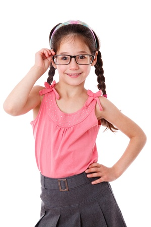 Adorable girl holding a glasses, isolated on white photo