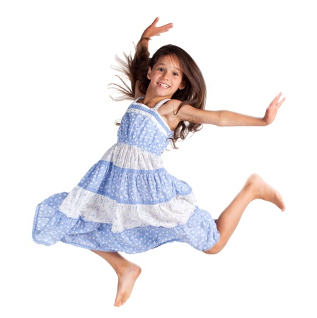 dancing girl: Jumping happy little girl, isolated on white Stock Photo
