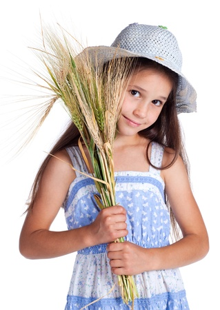 Beautiful girl with sheaf of wheat, isolated on white photo