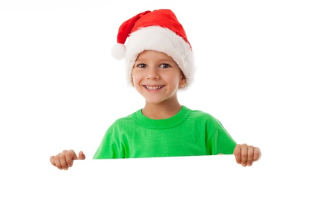 Christmas boy standing with empty horizontal blank in hands, isolated on white photo