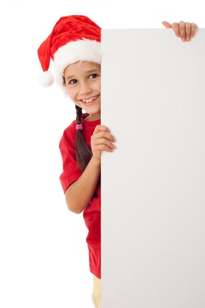 Christmas girl standing with empty vertical blank in hands, isolated on white photo