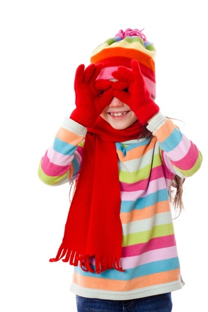 warm clothes: Playing girl in winter clothes looking through imaginary binocular, isolated on white