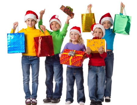 Group of happy kids with christmas gifts, isolated on white photo