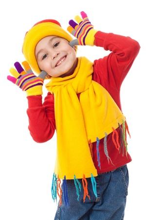 niños felices: Funny girl en ropa de invierno, aislado en blanco