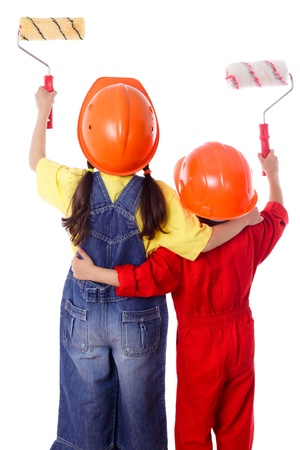 Little painters - Two kids in coveralls with paint rollers, rear view, isolated on white Stock Photo - 16057542