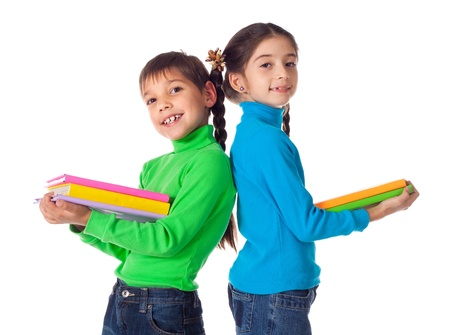 Smiling kids standing with colorful stack of books in hands, isolated on white Stock Photo - 16432131