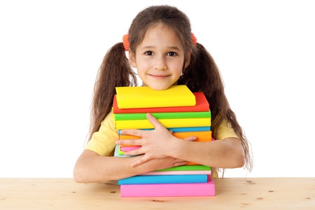 Smiling girl with pile of books, isolated on white Stock Photo - 16574725