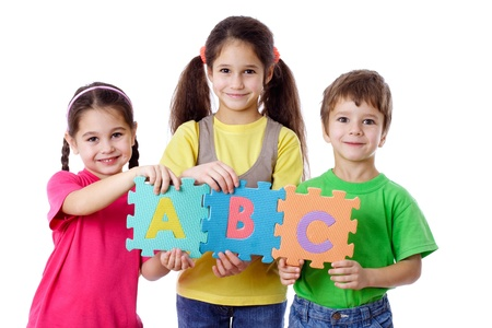 abc kids: Three kids with colorful letters, isolated on white