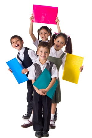 Four smiling schoolchild standing with colorful folders, isolated on white Stock Photo - 16985375