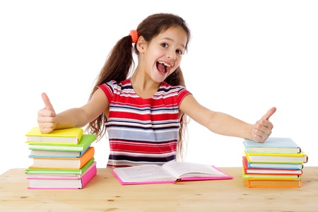 Girl with thumbs up sign sitting on the table with stack of books, isolated on white Stock Photo - 17334570