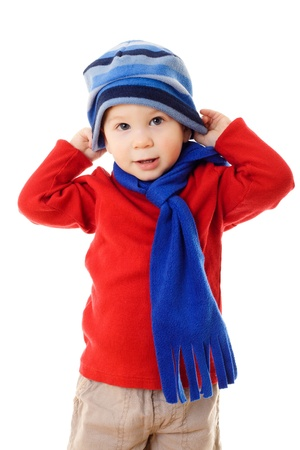 Little boy in winter clothes wearing the hat, isolated on white Stockfoto