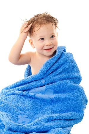 baby bath: Smiling little boy with wet head sitting in the towel, isolated on white