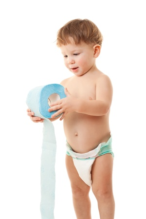 Smiling little boy standing with roll of toilet paper, isolated on white photo