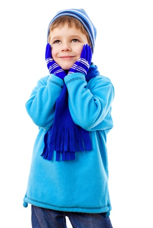 winter fashion: Thoughtful little boy in blue winter clothes, isolated on white