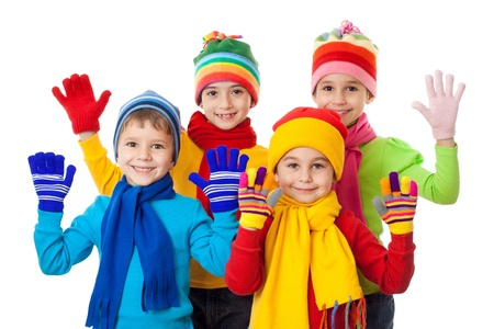 Group of kids in colorful winter clothes, isolated on white Stockfoto