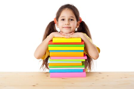Smiling girl with pile of books, isolated on white Stock Photo - 17669519