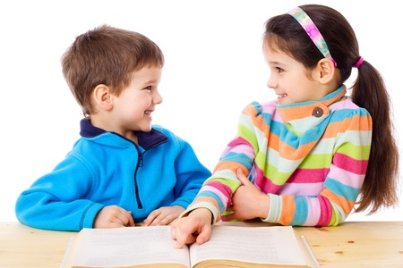 Two children are discussed about readed book, isolated on white Stock Photo - 18258062
